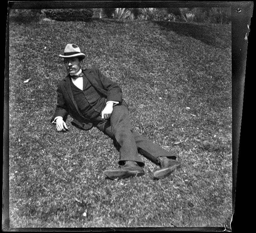 H. H. West reclines on the grass in MacArthur (Westlake) Park, Los Angeles, about 1898
