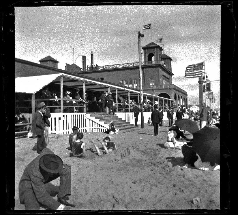 North Beach Bath House with people on the beach and the patio, Santa Monica, about 1895