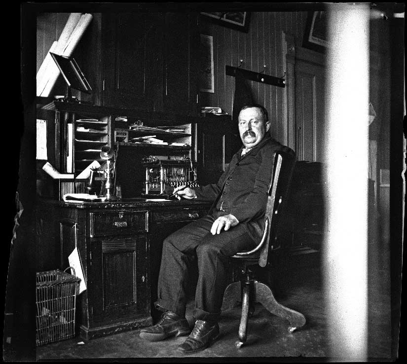 J. E. Brown in his office at the Southern Pacific Railroad Arcade Depot, Los Angeles, 1900