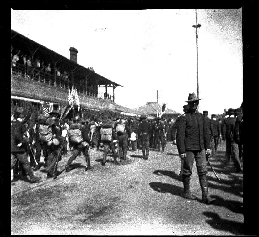 Military troops walking by Southern Pacific Railroad's River Station, Los Angeles, 1898