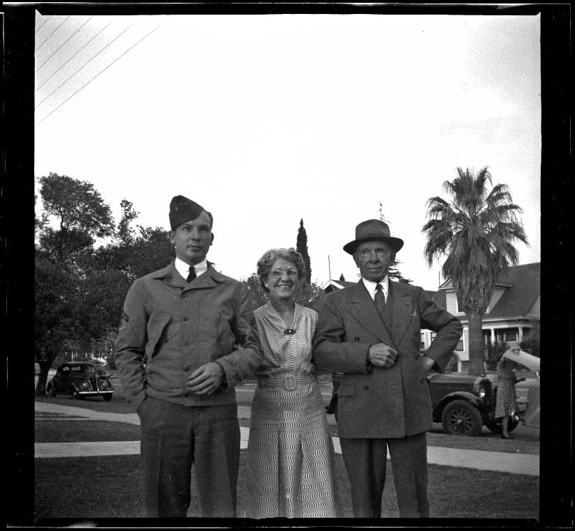 H. H. West poses with his wife, Mertie Whitaker West, and son, Los Angeles, 1941