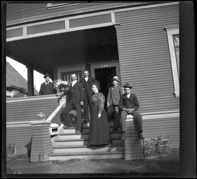 H. H. West and his siblings pose on their front porch with their cousin, William Mead, Los Angeles, about 1900