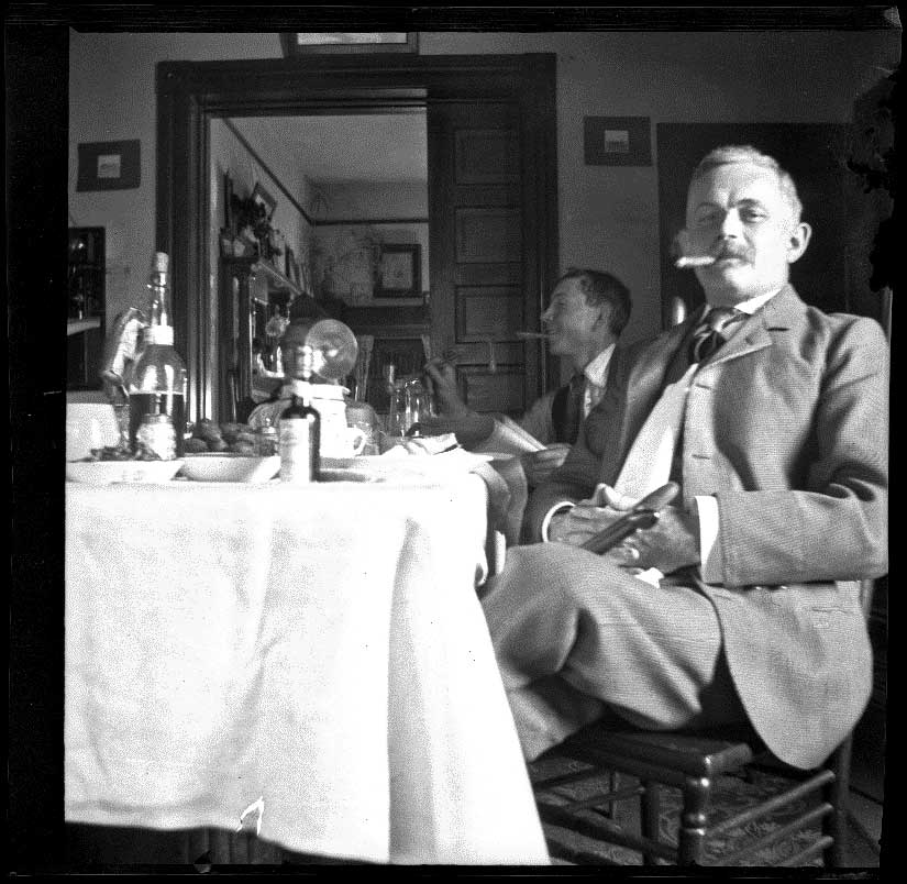 Wilhelmina West, Guy West, and H. H. Cooper sit around a table, Los Angeles,