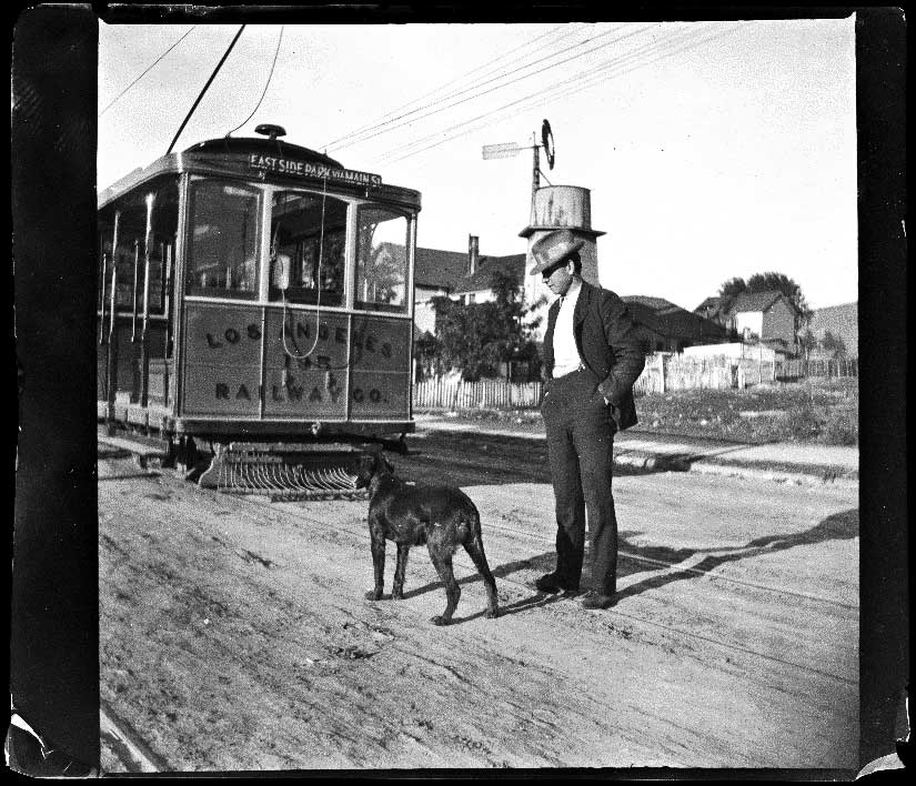 Guy West and his dog stand by a Los Angeles Railway car, Los Angeles, 1897