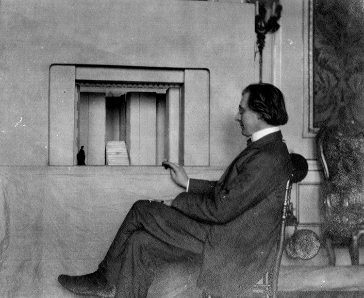 Craig sitting with model, 1913