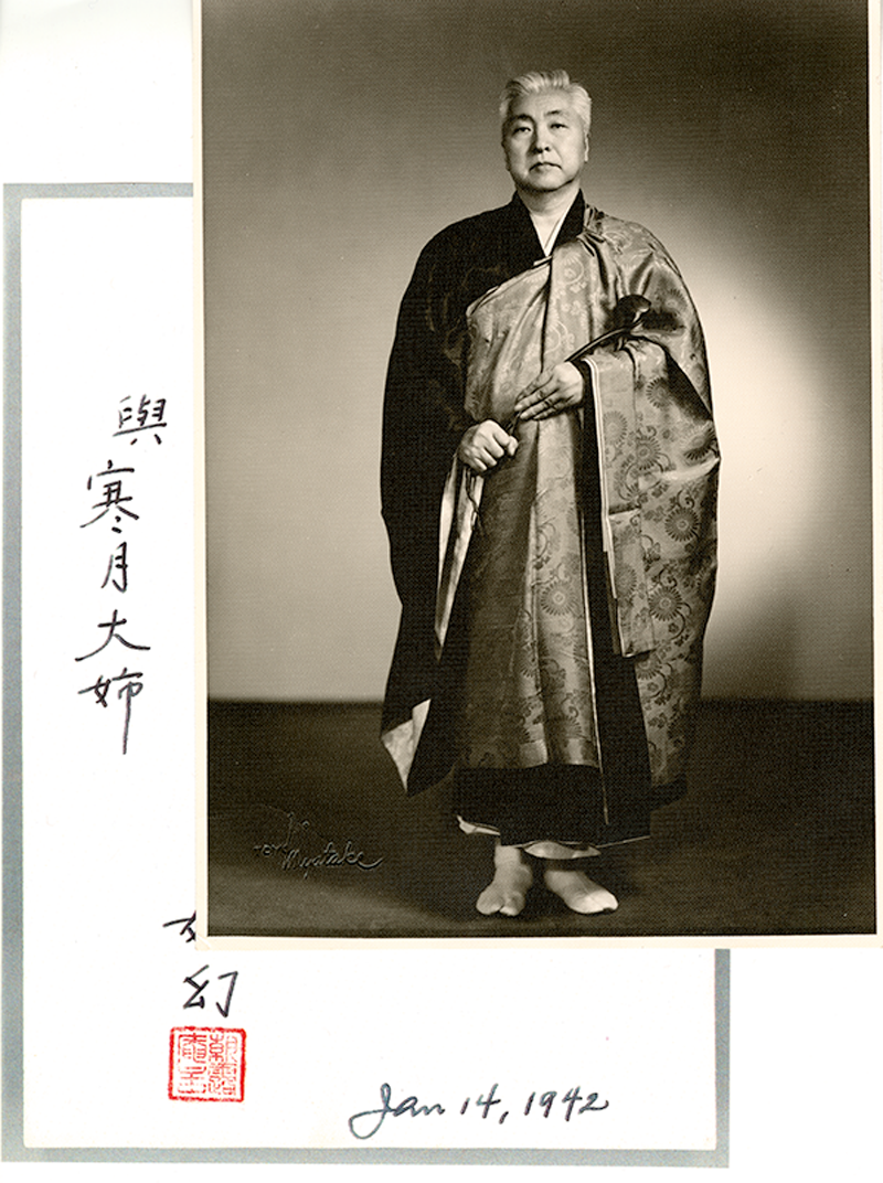 Nyogen Senzaki standing in Buddhist robes