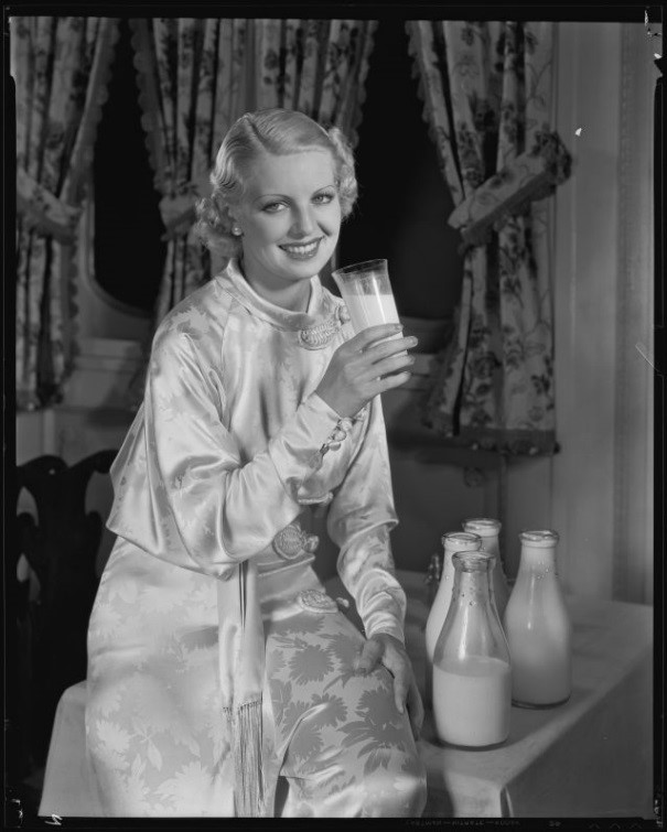 Allyn Drake, actress, posing for a milk advertisement, circa 1934