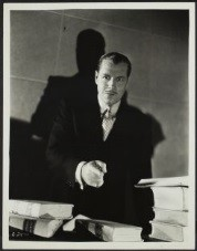 Jack Holt as Matthew Mitchell, a criminal defender, in The Defense Rests, 1934