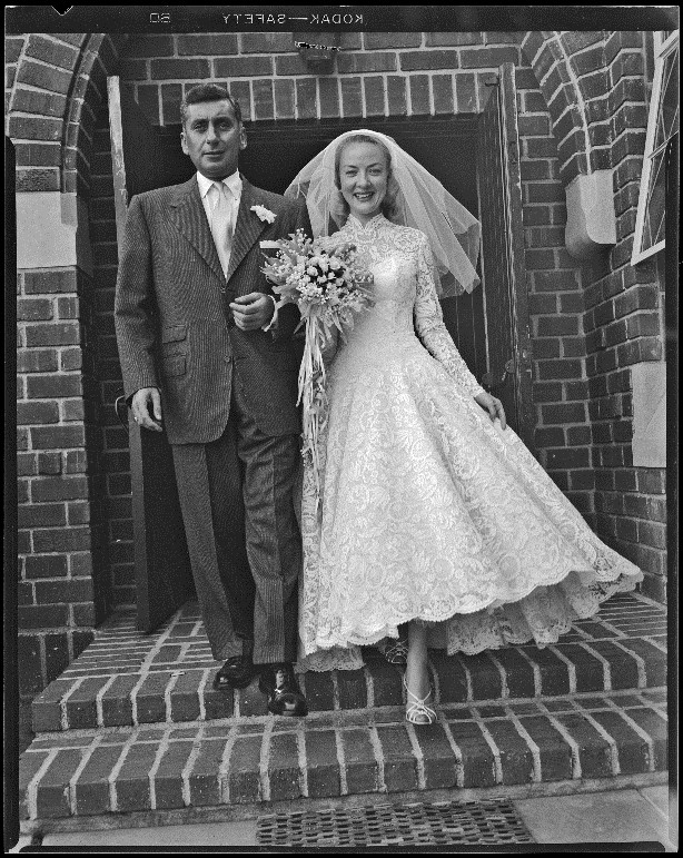 Audrey Totter, actress, with husband Dr. Leo Fred on their wedding day, 1952