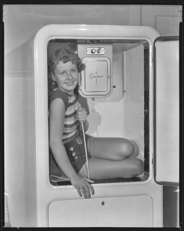 Barbara Reed, actress, sitting in a Grunow refrigerator, circa 1934-1936