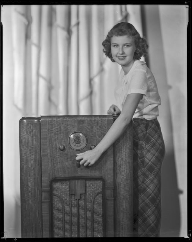 Barbara Reed, actress, with a radio, circa 1934-1936