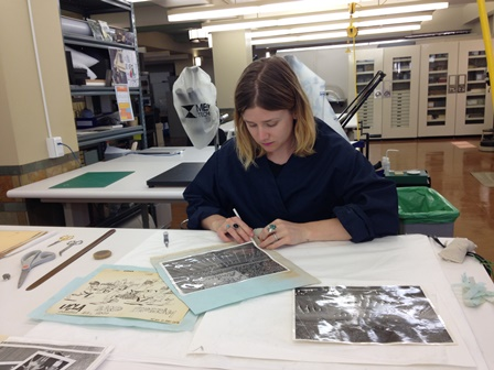 UCLA Marching Band Scrapbook during conservation work