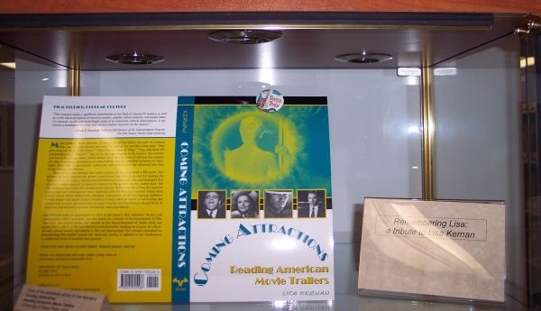 Close up of exhibit showing three books