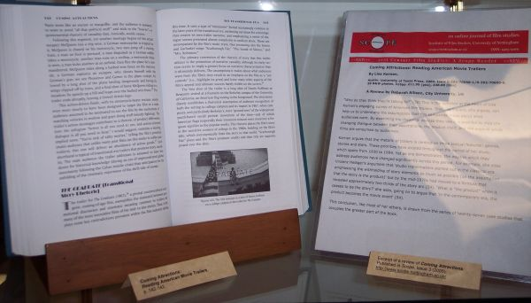 close up of exhibit showing open book and letter