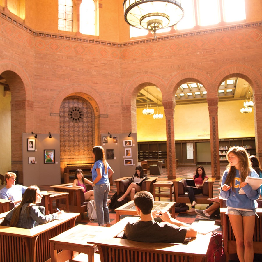 Students working and studying in the Rotunda of Powell Library