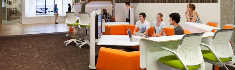 Picture of U C L A students working together in a collaboration pod at Young Research Library