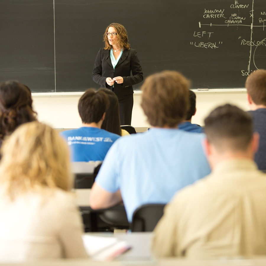 Lecturer addressing students in a classroom