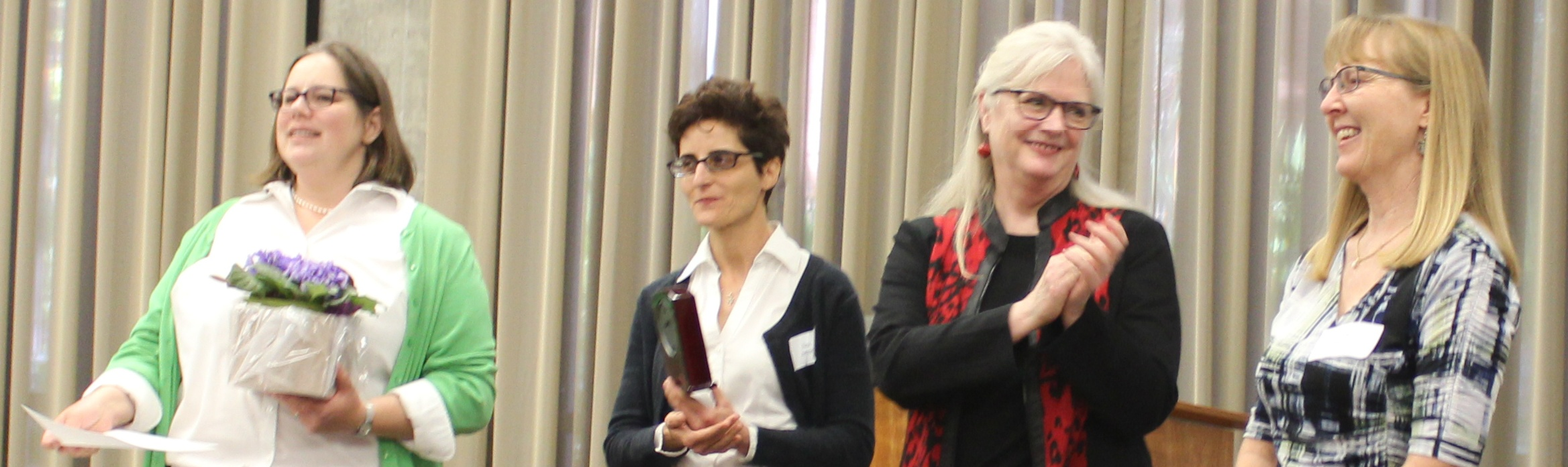 Photo of Kelli Ham receiving the Librarian of the Year Award from fellow librarians