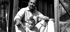 Artist Ed Kienholz and his son Noah sitting on steps of their home in Laurel Canyon, Calif., 1965