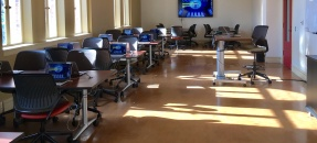 Image of tables and screens in classroom