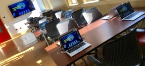 Image of desks and laptops