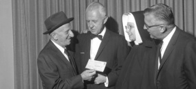 Jimmy Durante presenting check to St. John's Hospital administrators Santa Monica, Calif., 1964