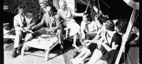 George and Ira Gershwin with students lounging in the sun, 1937