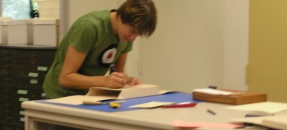 Photograph of student worker in Special Collections markers' area