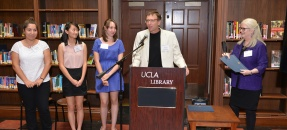 students receiving their library prize during ceremony