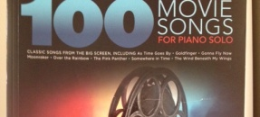 Cover of a music book with the title 100 Movie Songs