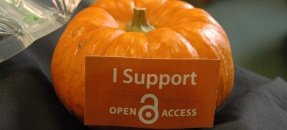 A pumpkin with a sign saying Support Open Access