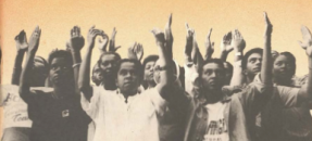 Cover image of protesters with hands upraised from Rio de Janeiro flyer