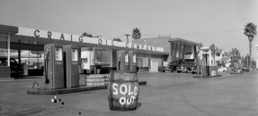 Craig Oil Company sold out sign in front of gas pumps in Los Angeles, Calif., 1948