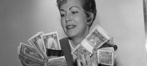 Bank teller, Mrs. Joe Melton holding amount of money that the average San Fernando Valley, Calif. family made in 1963