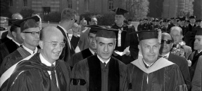 Shah of Iran, Mohammed Reza Pahlavi flanked by Dr. Clark Kerr and Franklin D. Murphy on UCLA campus after receiving honorary degree, 1964