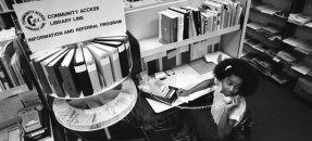 Information specialist Sylvia Curtis answering telephones for Community Access Library Line (CALL) in Montebello, Calif., 1980