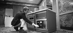 Mike Grady, Logicon Corp. engineer, demonstrating computer capable of voice recognition in Los Angeles, Calif., 1976