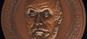 The portrait medal of Hippocrates (copper, 95 mm) was designed by Jacques Devigne for the Paris Mint in 1983. It is Sonnenschein #0650 in the Ralph R. and Patricia N. Sonnenschein Collection of Medical and Scientific Portrait and Commemorative Medals.
