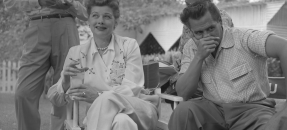 Actress Lucille Ball and husband, Desi Arnaz seated in directors chairs at press conference in Los Angeles