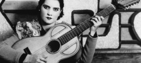 Lydia Mendoza: The First Lady Of Tejano, holding a guitar